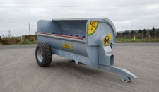 The Marshall MS90 side discharge muck spreader with a capacity of 9 cu.yds and a galvanised finish.